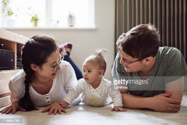 make time for tummy time - lying on front stock pictures, royalty-free photos & images