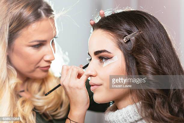 make up artist applying make up on model - stage make up stock photos and pictures