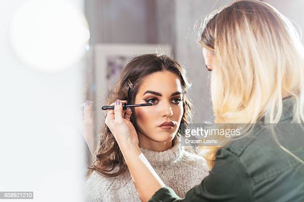 Make up artist applying make up on model