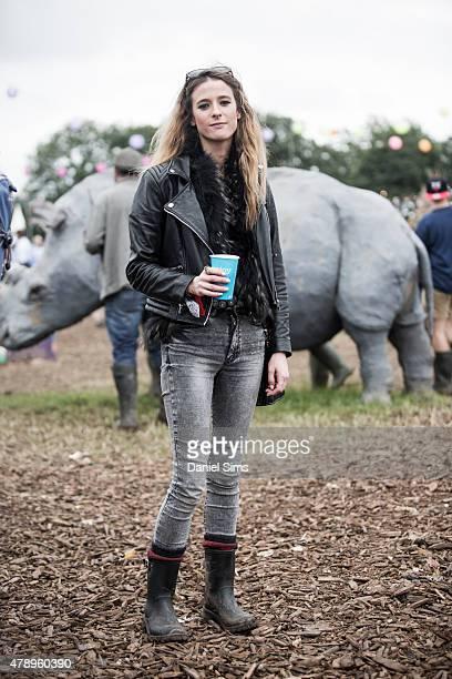 Make up artist Charlotte Cowen wears a Celine bag Rayban sunglasses Mango jeans Mango jacket Topshop top vintage fur Lucy Williams x Missoma...