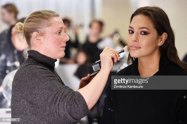 Make up artist Polly Osmond and model Ashley Graham prepare backstage at the Christian Siriano fashion show during New York Fashion Week at Grand...