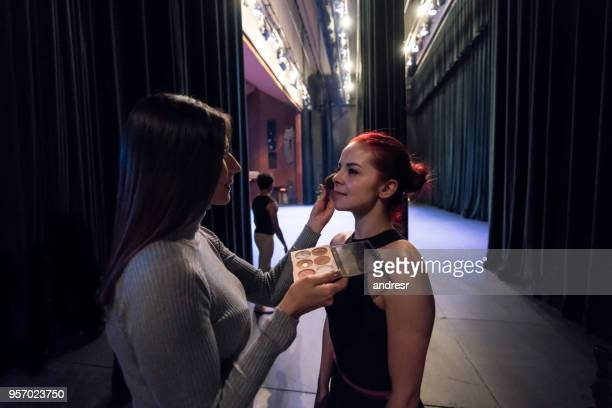 make up artist preparing a ballerina to go back on stage - rehearsal stock pictures, royalty-free photos & images
