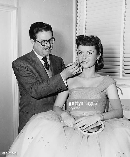 Make up artist William J Tuttle applying lipstick on actress Debbie Reynolds circa 1965