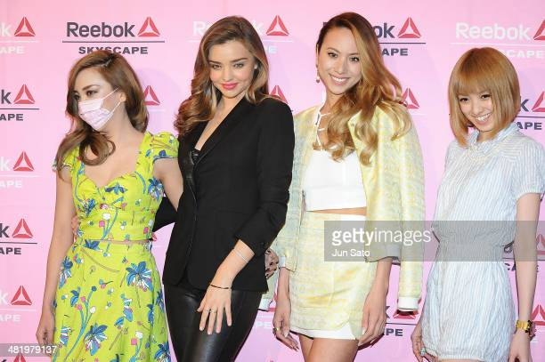 Make up artist Zawachin Tv personality Akina MInami models Miranda Kerr and Angelica Michibata attend the Reebok Skyscape party photocall on April 2...