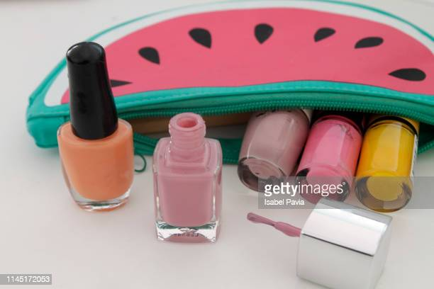 make up bag with nail polish - enamel stock pictures, royalty-free photos & images
