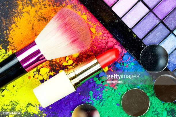make up on multicolored piles of pigment powder - vanity stock pictures, royalty-free photos & images