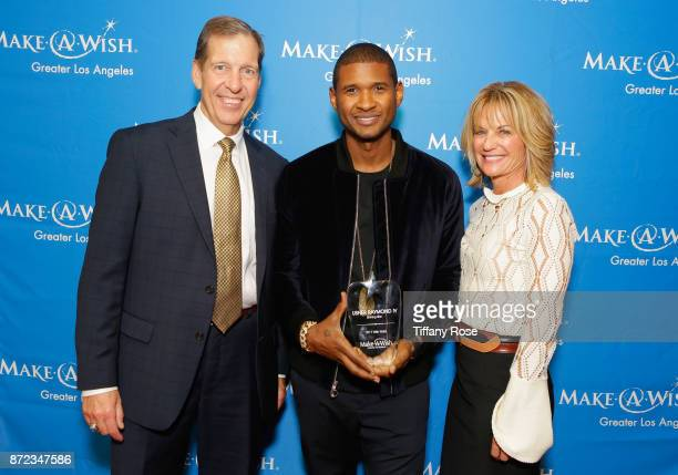 MakeAWish Foundation CEO Neil Aton and Shining Star award recipient Usher Raymond IV at the 2017 Make a Wish Gala on November 9 2017 in Los Angeles...