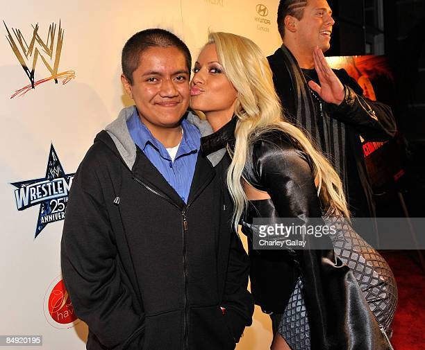 MakeAWish Foundation's Manuel Ramos poses with WWE Diva Kelly Kelly at WWE's opening night party honoring the 25th Anniversary of WrestleMania and...