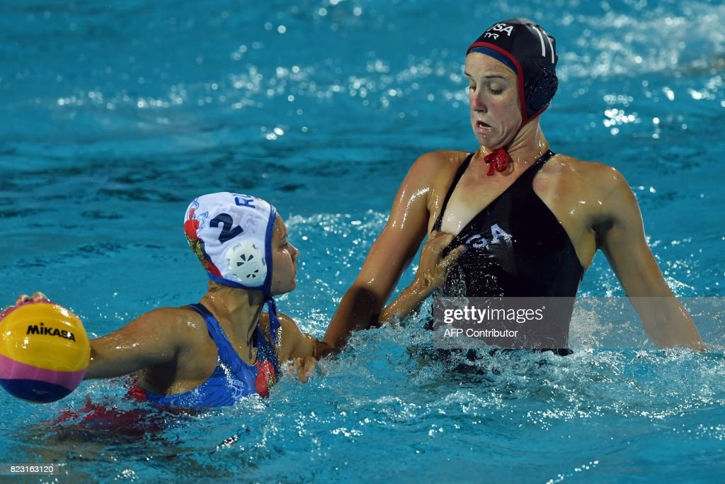 Makenzie Fischer (R) vies with Verinika Vakhitova (L) of Russia in 'Hajos Alfred' swimming pool on July 26, 2017 in Budapest during a semifinal match of FINA2017 world championships between their teams. /