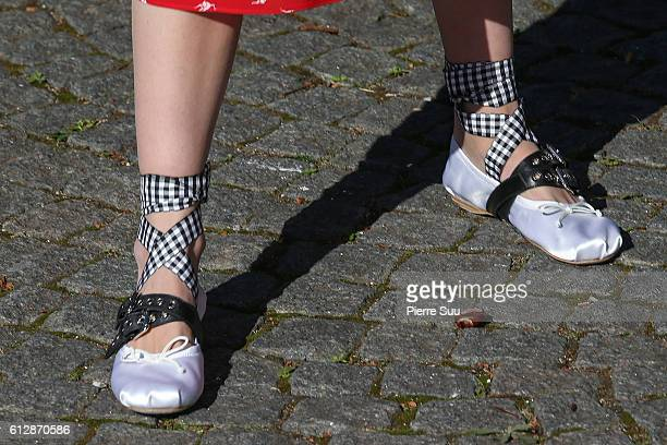 Makenzie Leigh shoe detail arrives at the Miu Miu show as part of the Paris Fashion Week Womenswear Spring/Summer 2017 on October 5 2016 in Paris...