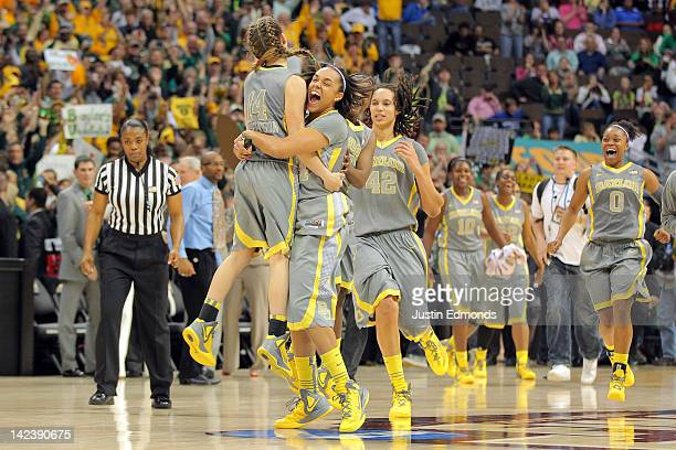 Makenzie Robertson Mariah Chandler and Brittney Griner of the Baylor Bears celebrate after they won 8061 against the Notre Dame Fighting Irish during...