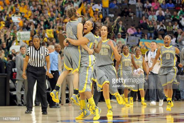 Makenzie Robertson Mariah Chandler Brittney Griner and Odyssey Sims of the Baylor Bears celebrate after they won 8061 against the Notre Dame Fighting...