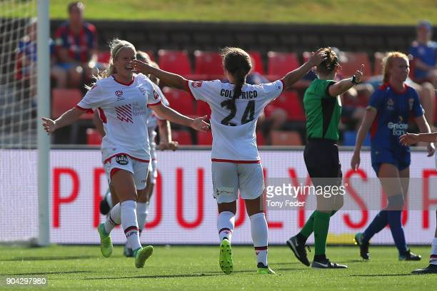 Makenzy Doniak and Danielle Colaprico of Adelaide celebrate a goal during the round 11 WLeague match between the Newcastle Jets and Adelaide United...