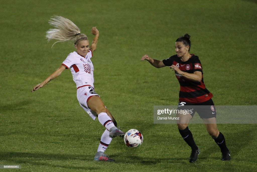 Makenzy Doniak of Adelaide United fights for the ball against Kahila Hogg of the Wanderers during the round two W-League match between the Western Wanderers and Adelaide United at Marconi Stadium on November 3, 2017 in Sydney, Australia.