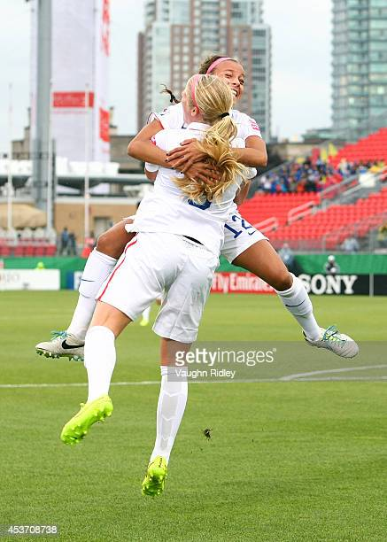 Makenzy Doniak of the United States celebrates with Mallory Pugh after scoring the opening goal during the FIFA U20 Women's World Cup Canada 2014...