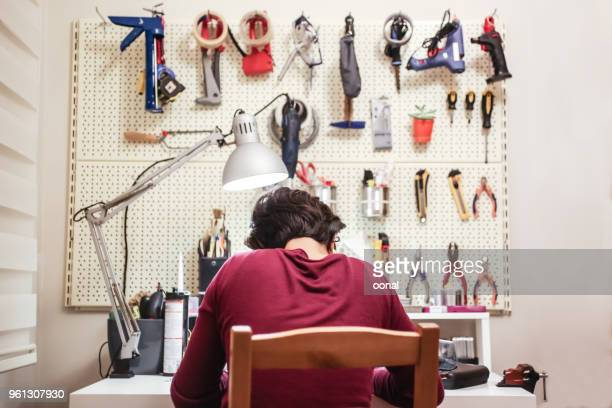 maker is working on his workshop - inventor stock pictures, royalty-free photos & images