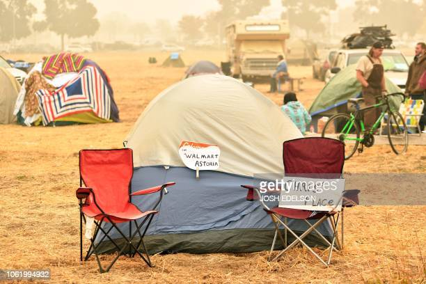 A makeshift address is seen on a tent at an evacuee encampment in a Walmart parking lot in Chico California on November 15 2018 The toll in the...