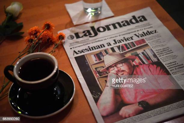 A makeshift altar with a cup of coffee water glass and newspaper headlining the story of slain Mexican journalist Javier Valdez is pictured in a cafe...