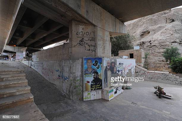 Makeshift grave marks the memorial to the Islamic State massacre of 1,700 Shiite Air Force cadets from Camp Speicher beneath a bridge where victims...