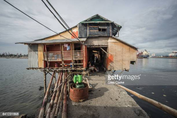 Makeshift house and residents live along the seawall of Tondo, Manila.