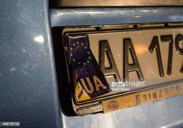 A makeshift license plate sticker with the European Union flag covers a part of a license plate on a car near Maidan Square on December 14 2013 in...
