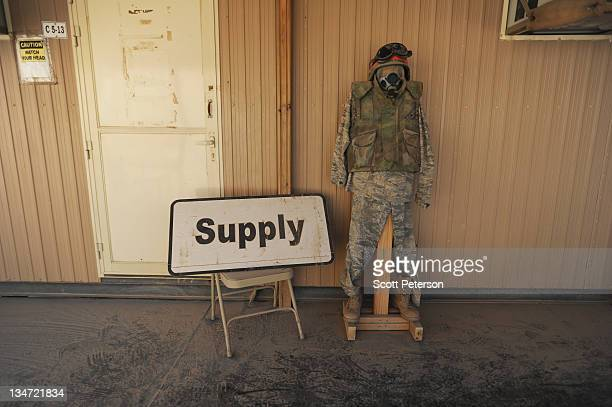 """Makeshift mannequin stands guard outside an empty """"supply"""" office as American soldiers prepare for flights to Kuwait for their final withdrawal from..."""