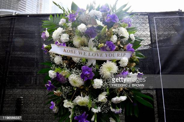 A makeshift memorial for former NBA and Los Angeles Lakers player Kobe Bryant is pictured after learning of his death at LA Live plaza in front of...