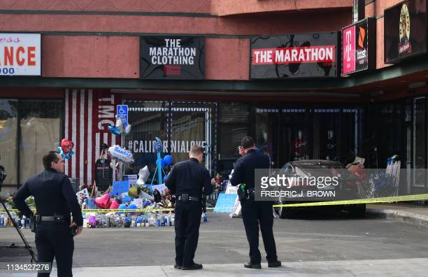 A makeshift memorial for Grammynominated rapper Nipsey Hussle sits in the parking lot in front of his Marathon Store in Los Angeles California on...