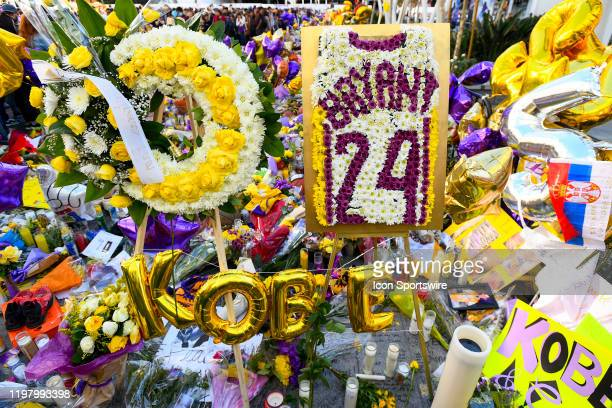 A makeshift memorial for Kobe Bryant and his daughter Gianna outside the Staples Center on February 1 2020 at STAPLES Center in Los Angeles CA