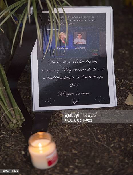 A makeshift memorial for reporter Alison Parker and cameraman Adam Ward at the gate of WDBJ television studios on August 26 in Roanoke Virginia...
