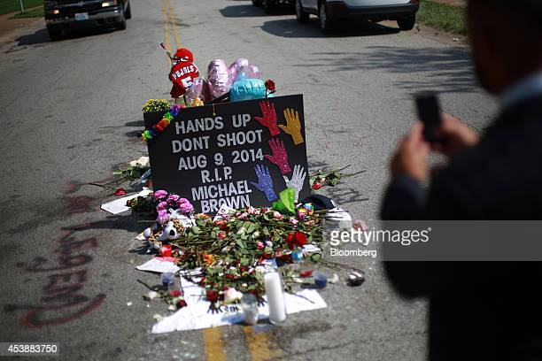 A makeshift memorial for shooting victim Michael Brown stands in the middle of Canfield Drive where Brown was shot in Ferguson Missouri US on...
