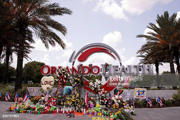 A makeshift memorial for the victims of the Pulse Nightclub shooting surrounds a sign near Orlando Regional Medical Center June 14 2016 in Orlando...