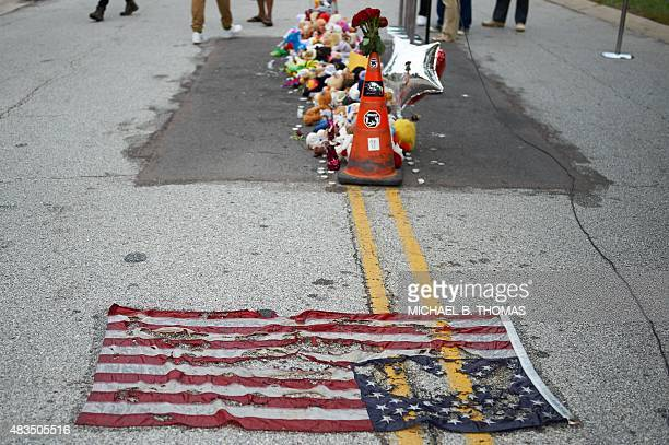 Makeshift memorial in the street during a memorial service for 18-year-old Michael Brown Jr. On August 9, 2015 at the Canfield Apartments in...