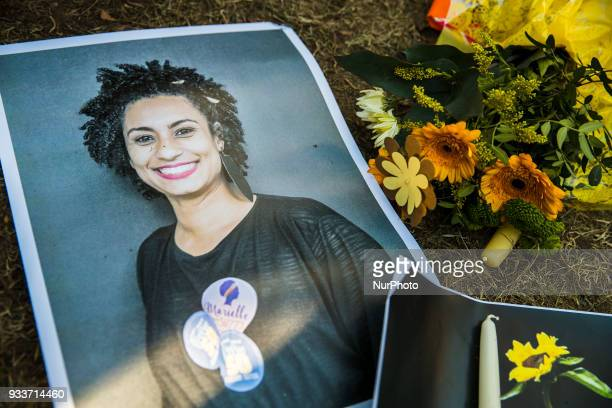 A makeshift memorial is pictured during a protest of Brazilian expats against the killing of Rio de Janeiro's left councilwoman and activist Marielle...