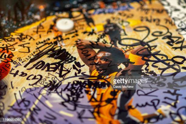 A makeshift memorial is seen as people mourn for former NBA star Kobe Bryant who was killed in a helicopter crash in Calabasas California near...