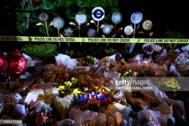 TOPSHOT A makeshift memorial is seen outside the Tree of Life Congregation October 30 2018 in Pittsburgh Pennsylvania US President Donald Trump and...