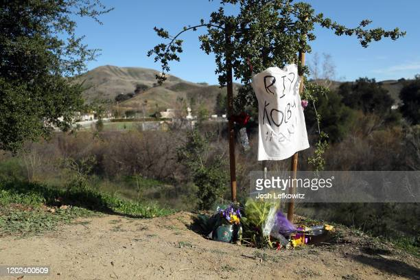 A makeshift memorial is shown near the site of the helicopter crash that yesterday claimed the lives of NBA great Kobe Bryant his daughter Gianna and...