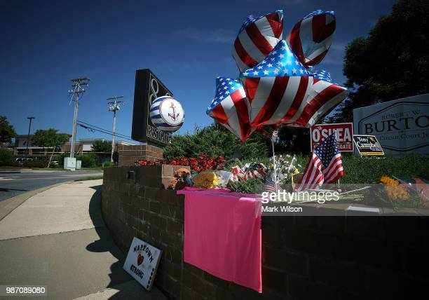 A makeshift memorial is slowly growing near the Capital Gazette where 5 people were shot and killed by a gunman on Thursday on June 29 2018 in...