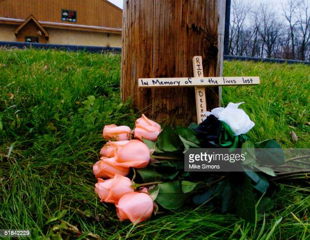 Makeshift memorial rests outside of the Alrosa Villa nightclub, the day after a gunman fired on the band Damageplan, December 9, 2004 in Columbus,...