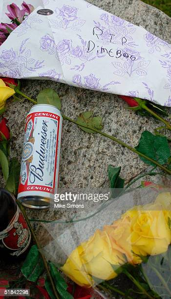 Makeshift memorial rests outside the Alrosa Villa nightclub, the day after a gunman fired on the band Damageplan, December 9, 2004 in Columbus, Ohio....