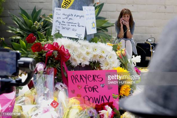 A makeshift memorial sits across the street from the Chabad of Poway Synagogue on Sunday April 28 2019 in Poway California one day after a teenage...