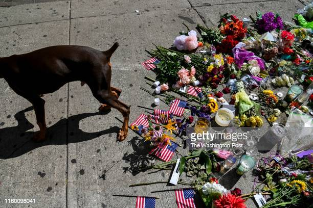 A makeshift memorial sits outside Ned Peppers Bar in the city's historic Oregon District where mass shooter Connor Betts used an AR15like rifle to...