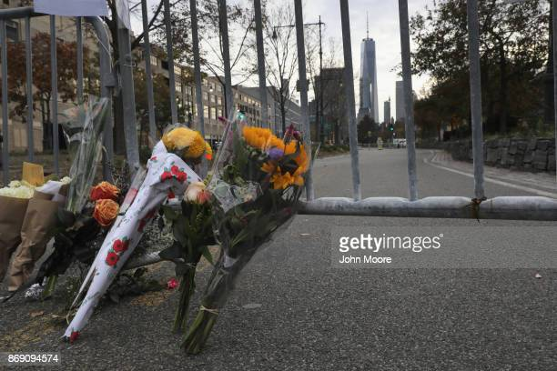 A makeshift memorial stands on a bike path in lower Manhattan on November 1 2017 in New York City Eight people were killed and 12 injured on October...