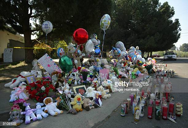 A makeshift memorial to the nine victims found shot to death in front of of the house where accused killer Marcus Wesson lived is shown March 17 2004...