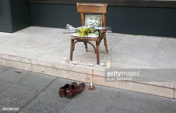 """Makeshift memorial with a picture of legendary shoe-cleaner """"uncle"""" Miso is seen on a main street in Sarajevo on January 7, 2014. Sarajevans paid..."""