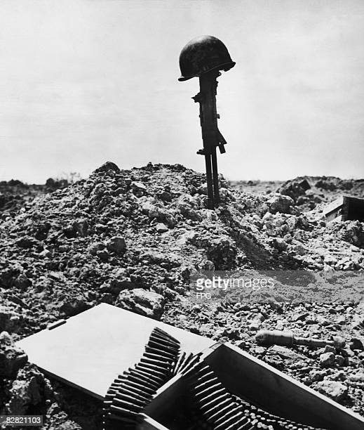 Makeshift monument to a dead American soldier at Normandy, after the D-Day assault on the coast, 1944.