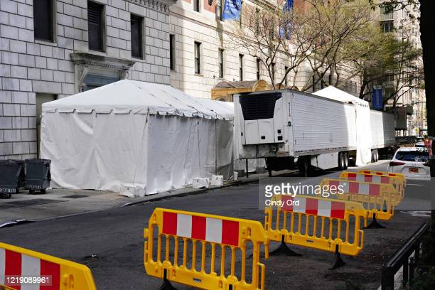 Makeshift morgue is set up outside Lenox Hill Hospital during the coronavirus pandemic on April 15, 2020 in New York City. COVID-19 has spread to...