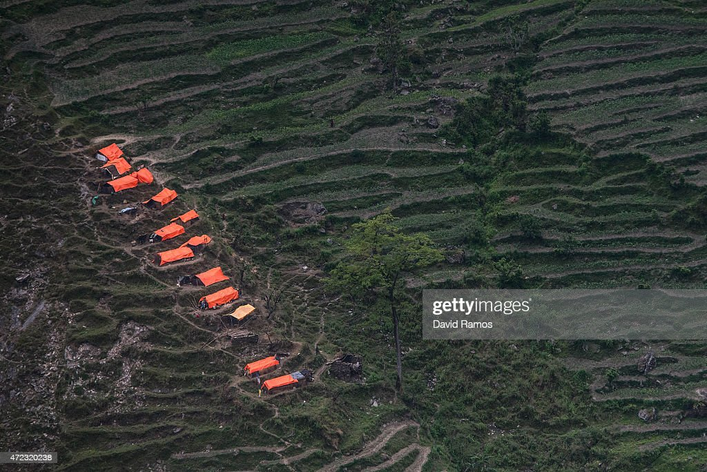 Makeshift shelters are seen from an Indian helicopter on May 6, 2015 in Hulchuk, Nepal. A major 7.9 earthquake hit Kathmandu mid-day on Saturday 25th April, and was followed by multiple aftershocks that triggered avalanches on Mt. Everest that buried mountain climbers in their base camps. Many houses, buildings and temples in the capital were destroyed during the earthquake, leaving over 7000 dead and many more trapped under the debris as emergency rescue workers attempt to clear debris and find survivors. Regular aftershocks have hampered recovery missions as locals, officials and aid workers attempt to recover bodies from the rubble.