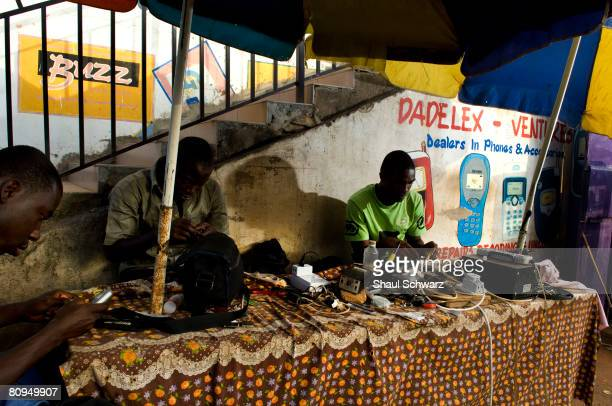 A makeshift table operates as a street phone lab in a busy market in Accra November 18 2007 in Ghana Nokia has invested great amounts into...