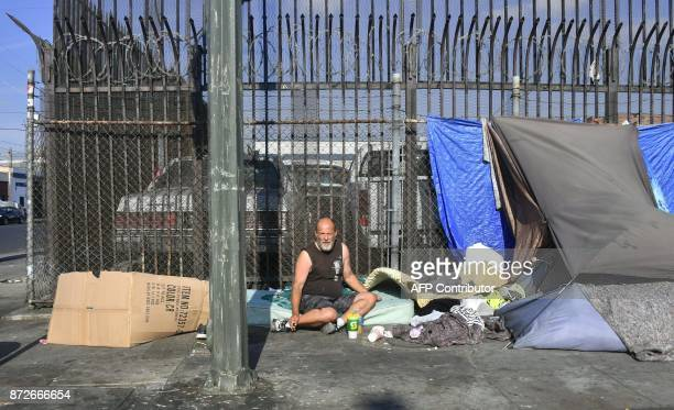 Makeshift tents house the homeless on a street November 10 2017 in Los Angeles California home to one of the nation's largest homeless populations...